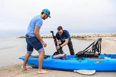 TAMU-CC students Austin Clark (left), and Andrew Rance equip their modified kayak as they prepare to test their capstone project.
