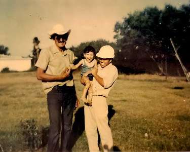 Grandparent's home on the King Ranch - Left to right José V. Sandana (grandfather), me, Yndalecio I. Hinojosa (father) (around age three).