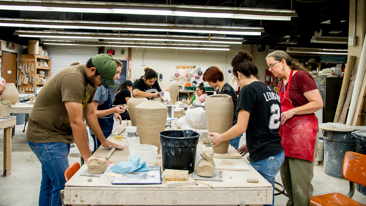 Professor Gail Busch guides har students for their exercises in her Ceramic 1 class at Center for Arts.