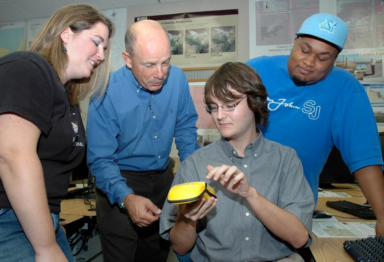 Dr. Phillip Davis (second from left), Del Mar College Computer Science Professor, covers different functions used on a Global Positioning Systems device to former students who majored in pro ...