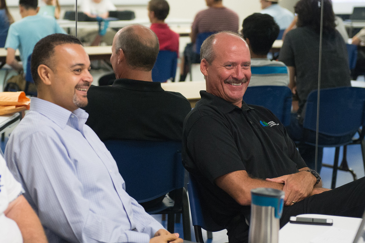 David Bridges(left)  Ahmed Mahdy and Joe Miller provide assistance during the UAS Summer Institute Camp at TAMU-CC.