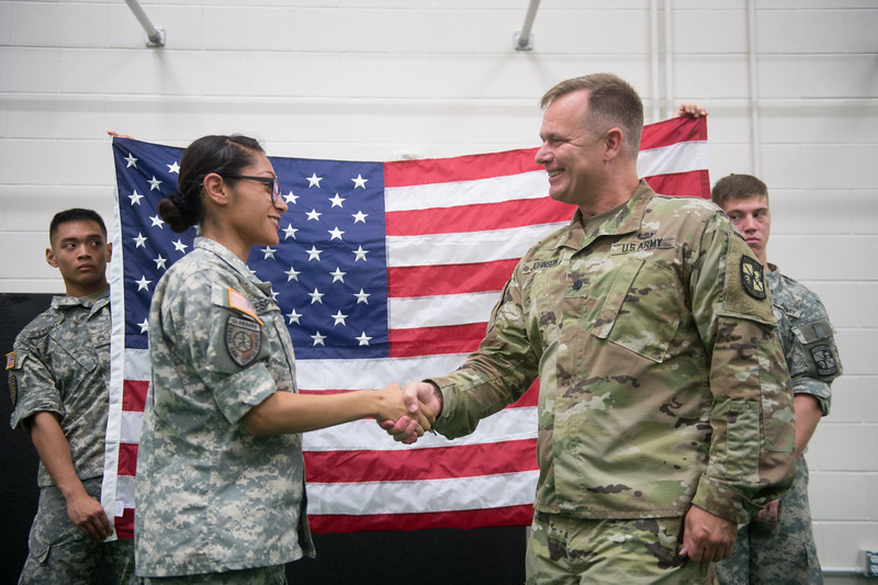 Cadet Jenieve Espinoza receives the Oath of Enlistment from LTC (Lieutenant Colonel or LtCol) Johnson following the ROTC Alcohol Awareness & Suicide Prevention lab.