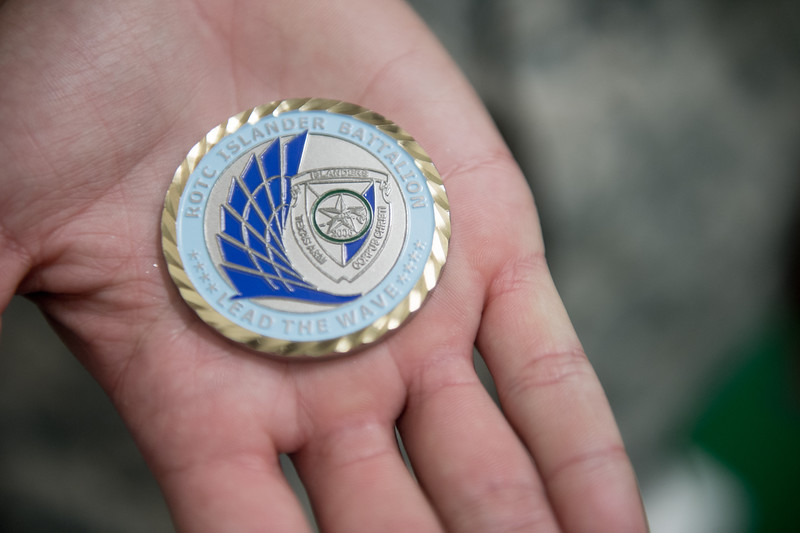 """Islander Army ROTC challenge coin, very long history within the military for challenge coins.<br /> Typically awarded to a service member for accomplishments during duty, exceeding standards or completing a tough task (challenge). Attached is a link with a little more on the history.<br /> <a href=""""https://en.wikipedia.org/wiki/Challenge_coin"""">https://en.wikipedia.org/wiki/Challenge_coin</a>"""