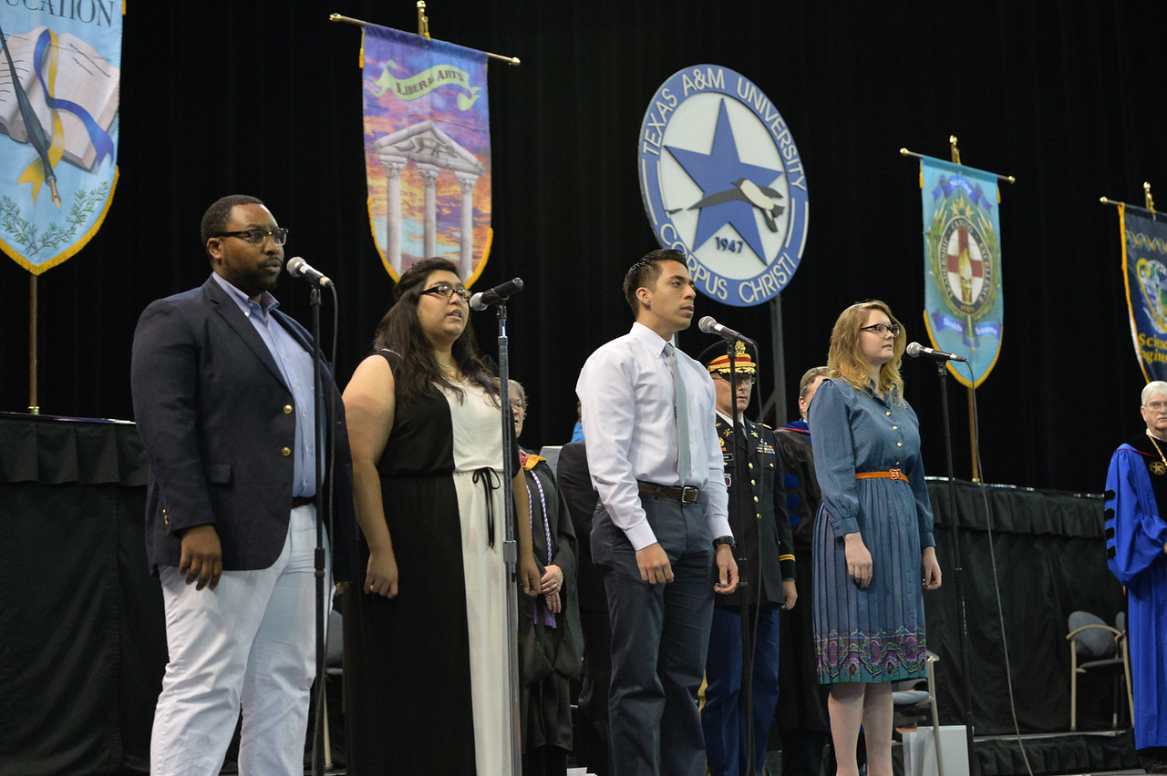 John Washington(left) Yvonne Alaniz, Frank Garcia and Janell Stallard perform the TAMU-CC Alma Mater during the 2015 Spring Commencement at the American Bank Center.