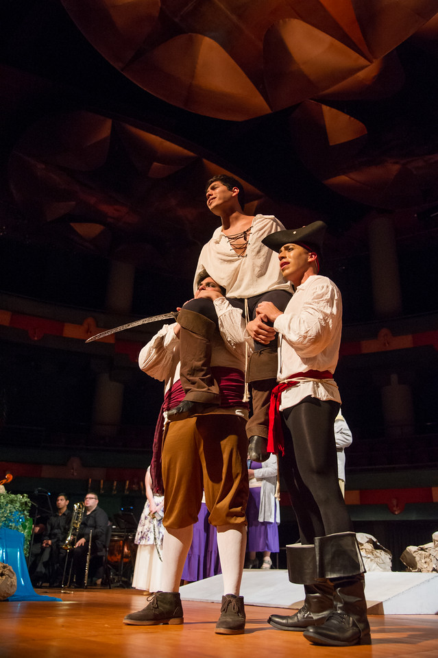 Freddy Acevedo, The Pirate King, is lifted off the ground by Eli Gonzalez and Frank Garcia Jr. during The Pirates of Penzance performance.