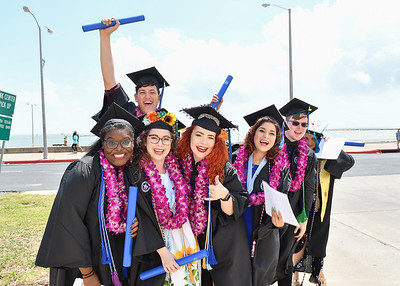 Recently graduated students pose for a photo together after the Spring 2018 Commencement ceremony held on May 12, 2018.