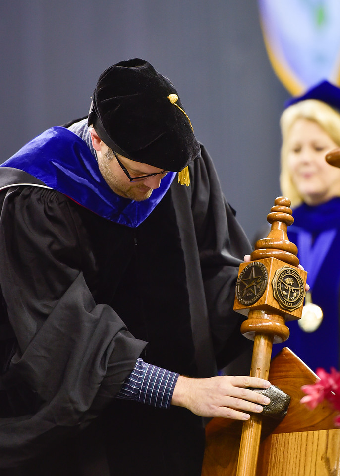 Mace-bearer Dr. Benjamin Walther places the mace performs his duties during the Spring 2018 Commencement ceremony on May 12, 2018.