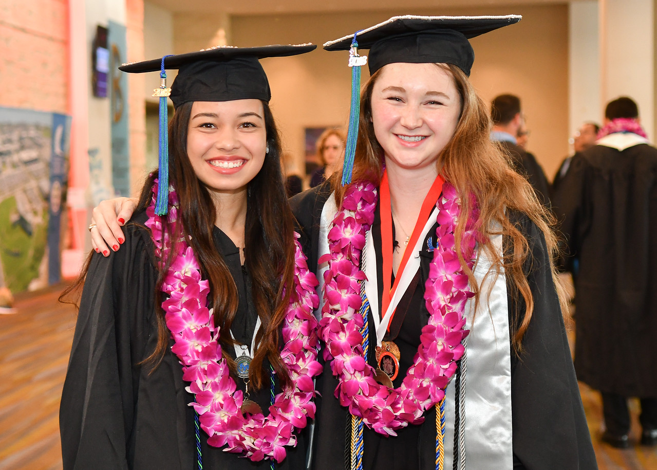 Leah Bernhardt (left) and Hailey Wallgren are two of more than 1100 Islanders who received their degrees during two Commencement ceremonies held on May 12, 2018.