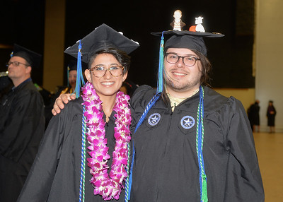 Bachelors of Fine Arts Tanu Alexander (left) and Jared Brandt pose for a photo before the Spring 2018 Commencement ceremony held on May 12. 2018.