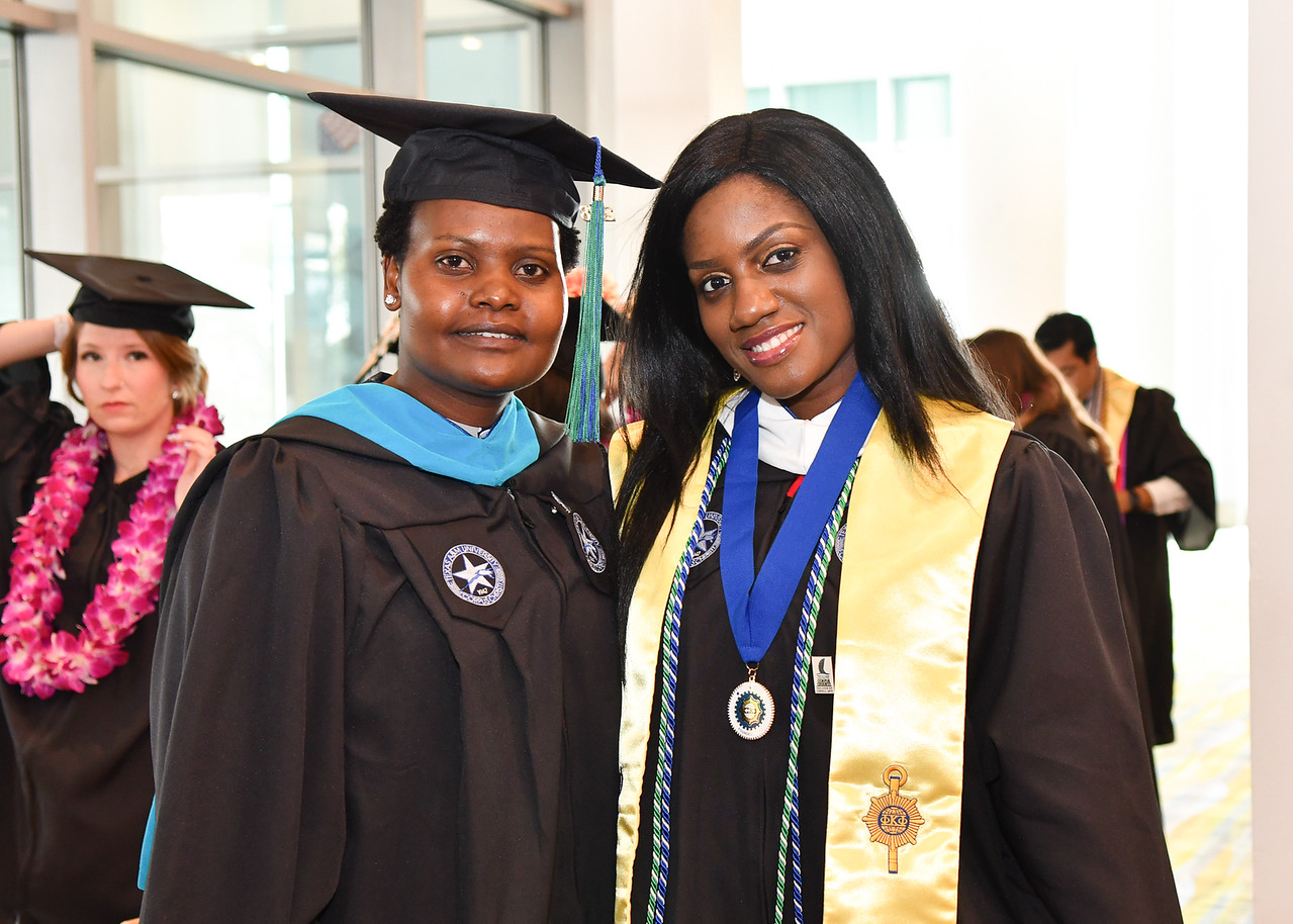 Julia Sambu  (left), and Bukky Balabola are two of more than 1100 Islanders who received their degrees during two Commencement ceremonies held on May 12, 2018.