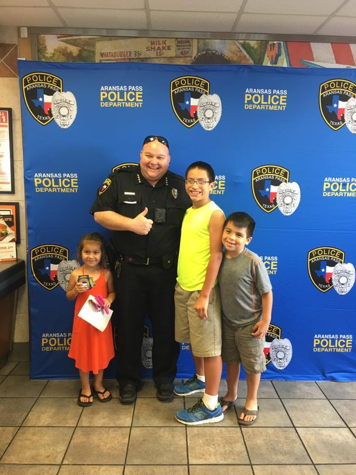 Aransas Pass Police Department Chief Eric Blanchard interacts with young citizens.