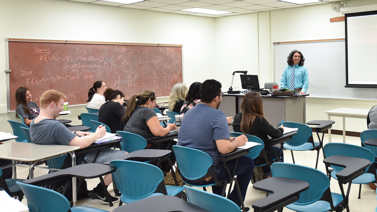 Professor Michael Ramirez gives a lecture during his sociology through film course.