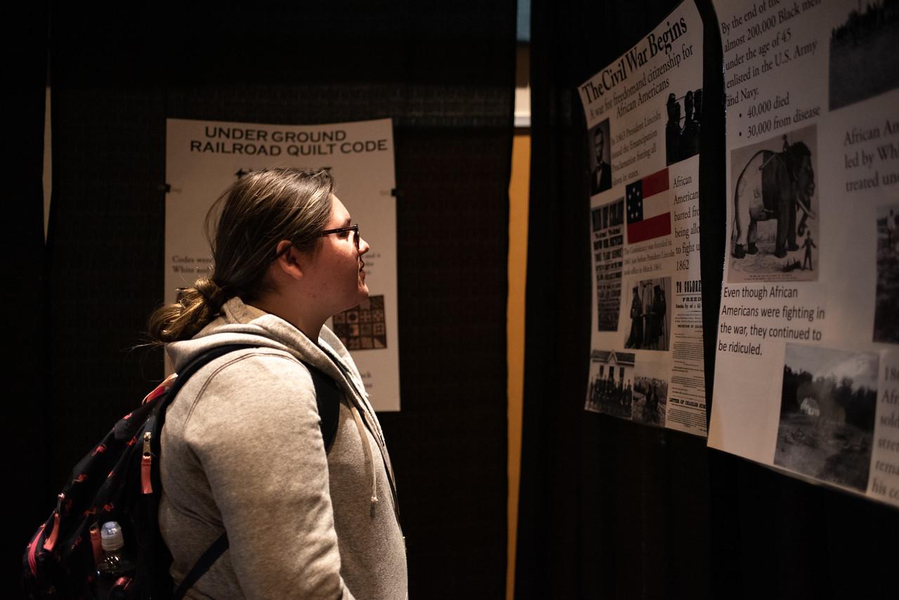 Bio-Medical major Lauren Lara steps into the Black History tunnel at the University Center Lonestar ballroom in honor of Black History month.