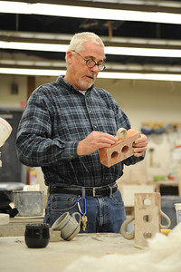 Greg Reuter goes over techniques in his ceramics class.