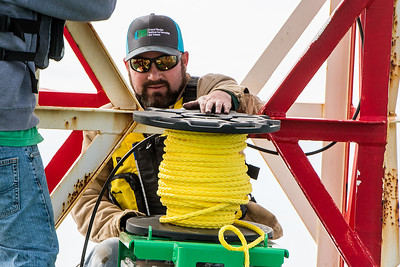 TAMU-CC Conrad Blucher Institute research engineer Zachary Hasdorff holds onto rope used to tie around a buoy during a CCPORTS module installation off of the coast of Port Aransas, Tx.