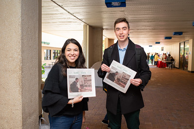 SGA President Sarina Garcia (left) and College of Business Student Senator Kirk Jorgensen pick up copies of the newest Island Waves publication.