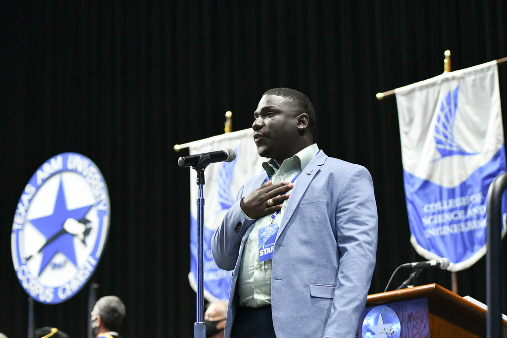Theodore Woods IV, College of Liberal Arts Public Administration graduate student, sings the National Anthem at the summer 2021 commencement ceremony at the American Bank Center.