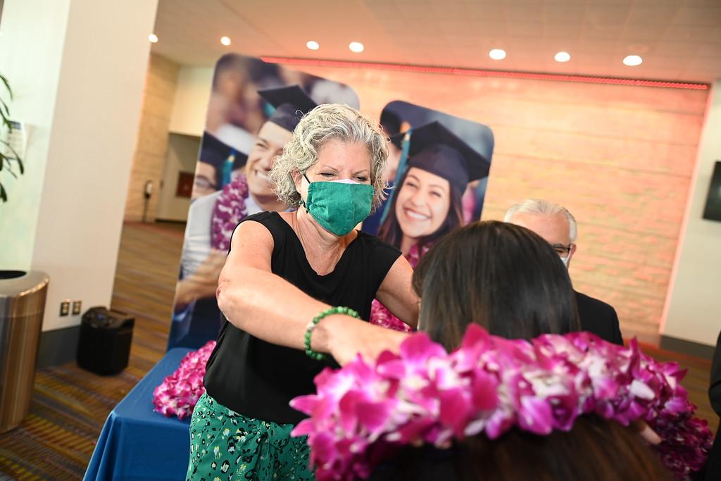 Islanders pick up their graduation lei from members of the National Islander Alumni Association.