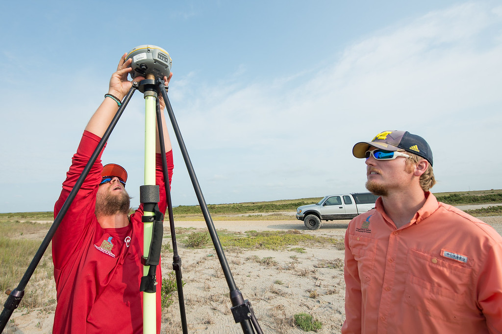 Alistair Lord (left) and Brian Lorentson install one of several instruments used during the survey of the Mustang Island area  The Conrad Blucher Institute  collects data following Hurricane ...