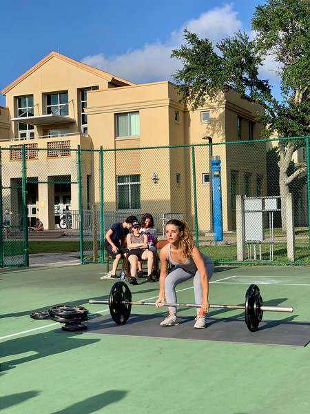 Third-year Isabella Cibelli DuTerroil deadlifts at the mock powerlifting meet May 4.