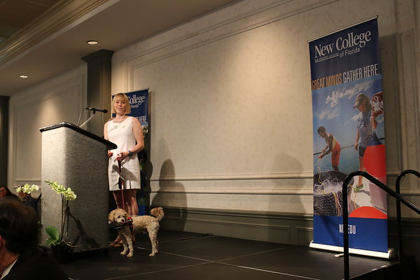 Cassidy Heaton and her service dog address luncheon attendees.