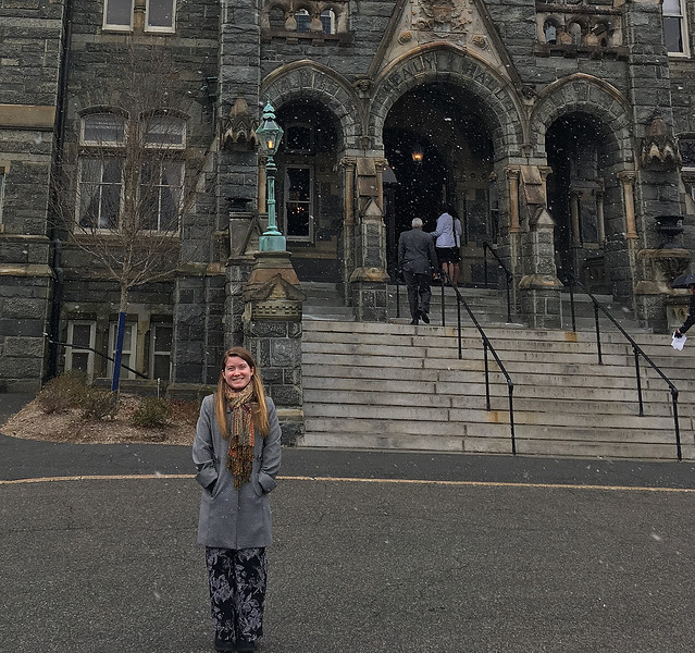 Kallie Delis at the entrance of Gaston Hall at Georgetown University.