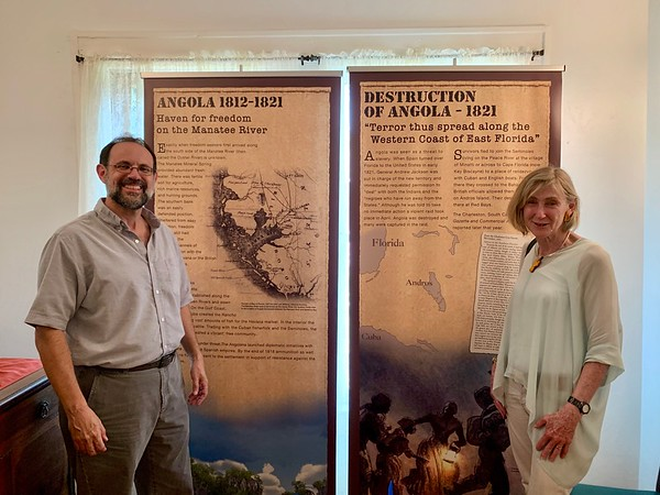 New College Professor of Anthropology & Heritage Studies Uzi Baram and alum Sherry Svekis at the Visitors Center of the Curry Houses Historic District in Bradenton which features a permanent exhibit that tells the story of Angola, a settlement established by former slaves and Seminoles in the early 1800s.