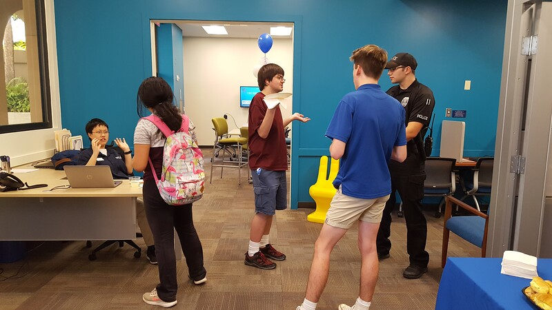 Peer mentors Jennifer Lin and Jacob Wenz talk with students at the CEO.