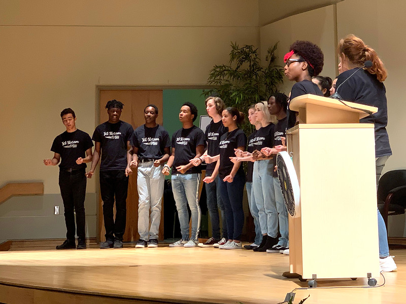 "Booker High School's Jet Stream choir performs ""Stand By Me"" before the panel discussion."