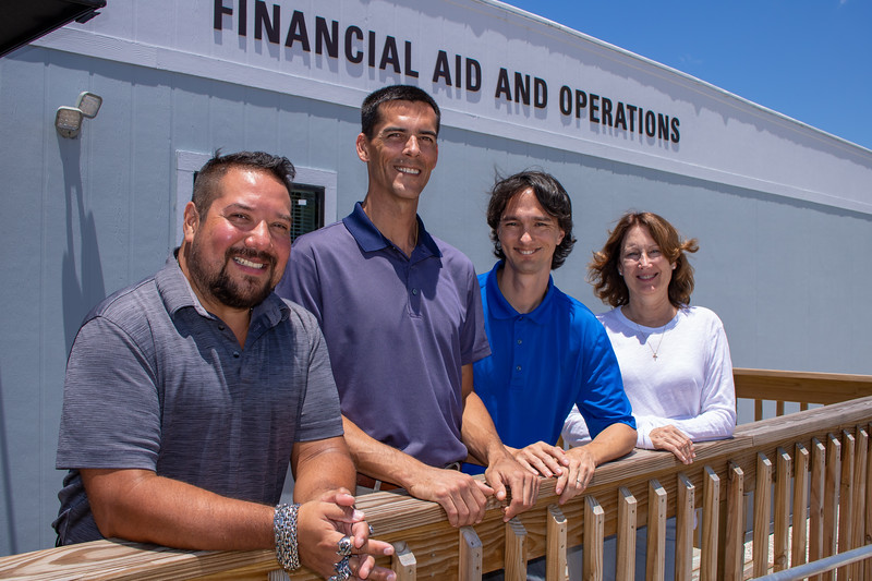 From left, Financial Aid assistant directors Corey Hill and Corey Kleppinger, Aid Coordinator Jonathan Torkos and Associate Director Kim McCabe man the Financial Aid office on the Pei Campus.