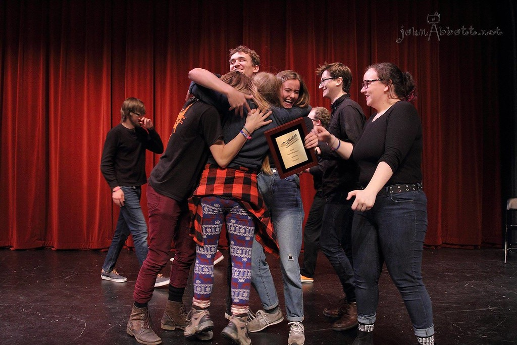 Members of the New College club Comedy Friends celebrate after placing fourth in a national competition of collegiate improv groups in February.