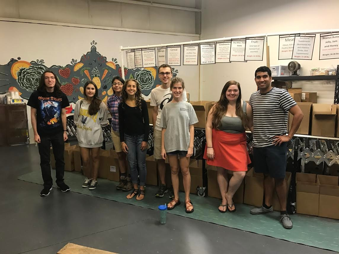 New College student volunteers recently spent time at All Faiths Food Bank in Sarasota.