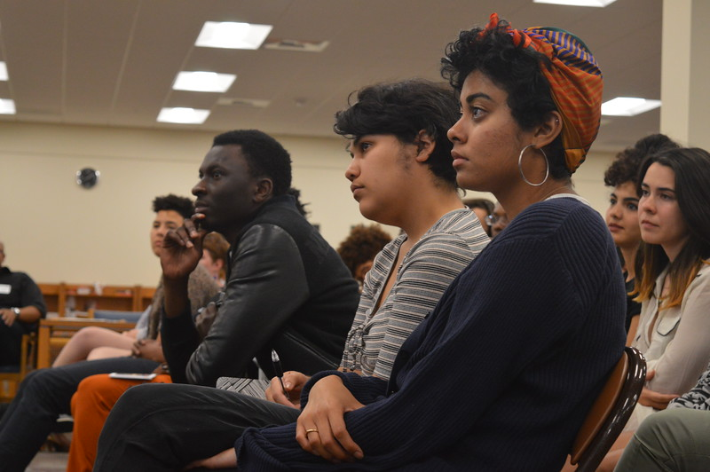 Students listen to poet and activist Kavindu Ade at the Symposium on Redefining Activism: Navigating Identity and Self-Care on March 4.