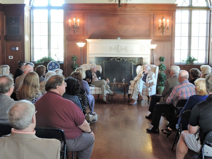"""Author John Jakes and his friend, author Don Bruns, held a """"fireside chat""""in the College Hall Music Room April 5."""
