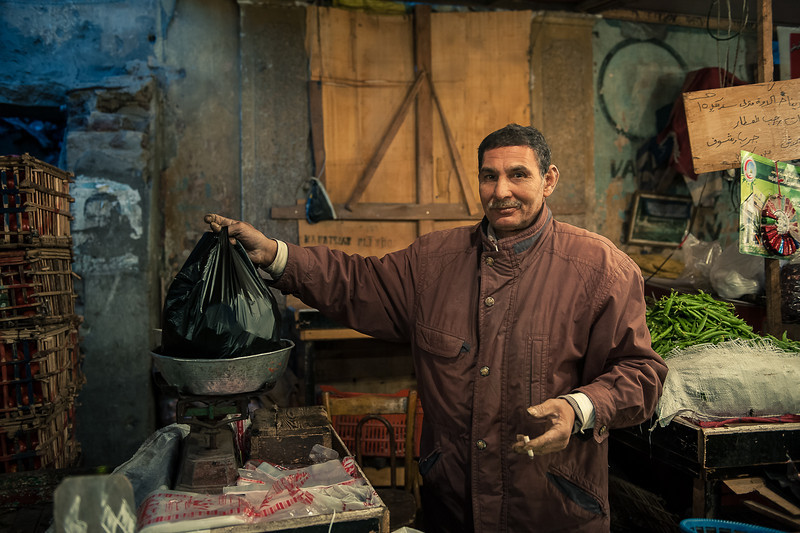 Ragab, offers spices and sweet peas. you can see how harsh it is farming by looking at his hands.