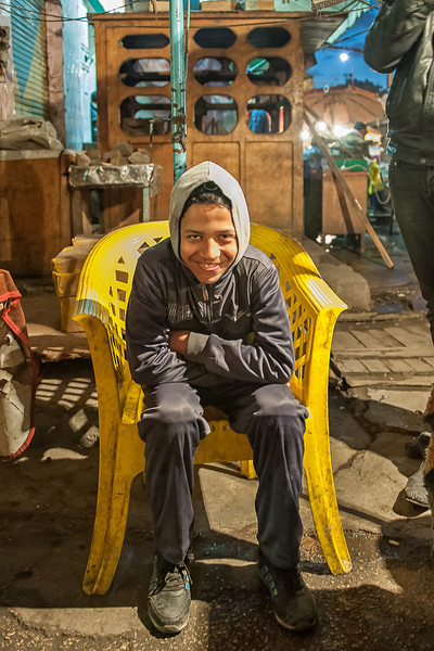 """Ashraf El Sghayer """"The Little"""", the guard, stays all night, watching for the goods, he hides a machete, just in case if needed."""