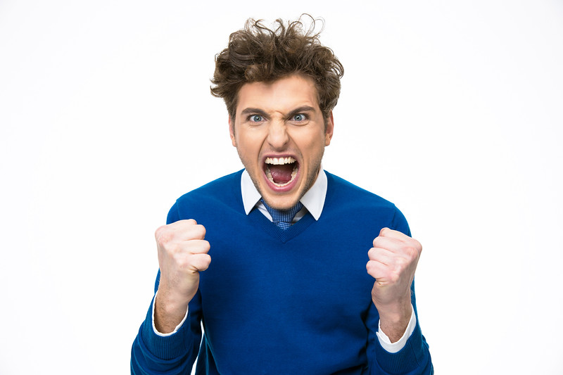 Angry business man shouting over white background