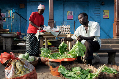 People sell vegetables along a street in Bo, Sierra Leone, December 4, 2008.