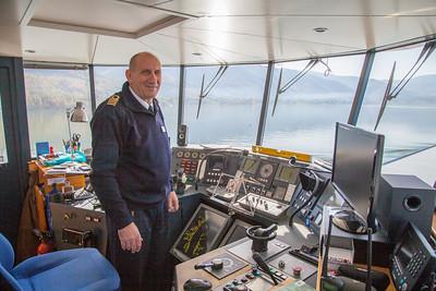 Serbian captain pilots a passenger boat along the Danube.