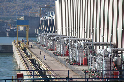 The  Iron Gate Hydroelectric Power Station,  the largest dam on the Danube river and one of the largest hydro power plants in Europe. It is located on the Iron Gate gorge, between Romania and Serbia. Power production is split between two plants, one owned by Romania and the other by Serbia. The project started in 1964 as a joint-venture between the governments of Romania and Yugoslavia and at the time of completion in 1972, it was one of the largest hydroelectric power stations in the world.