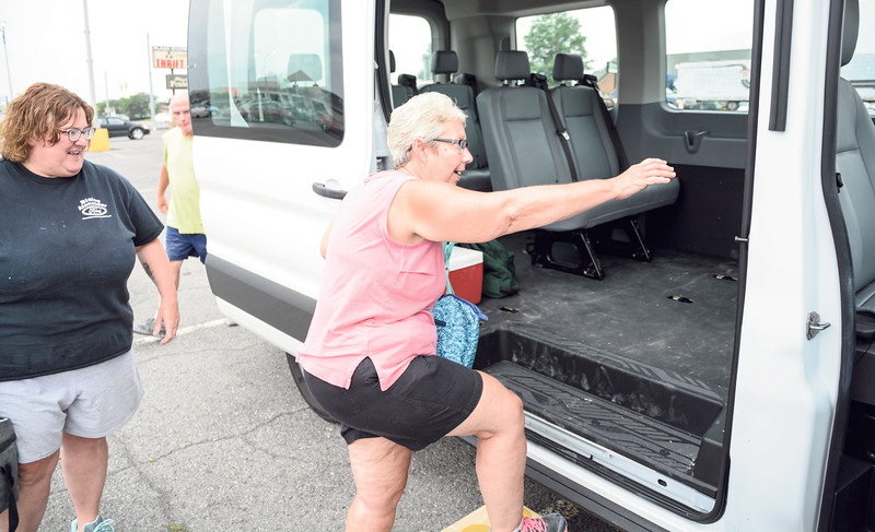 Robert Inglis/The Daily Item  Former Woodmode employees Paula Hoke, left, and Rose Forry, hop into a van that will take them to their new job .......