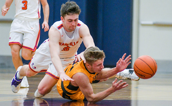 Danville's Shane Kozick falls on Montoursville's Dylan Bower as they chase a loose ball during Thursday's HAC tournament game.