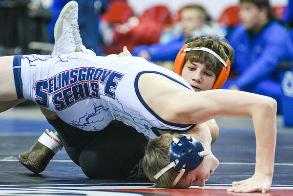 Selinsgrove's Aiden Gaugler fights off a pin from Northampton's Alexander Hanley during their 113 lb match on Thursday evening during state duals in Hershey.