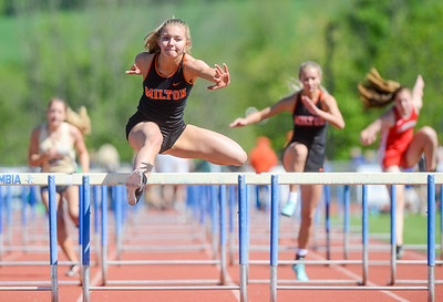Milton's Leah Bergey competes in the hurdles during Saturday's meet at Central Columbia.