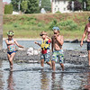 Robert Inglis/The Daily Item  Lillyanna Wolfe, 8, left, walks in the Susquehanna River with her brothers Cole, 6, and Lane, 10, and their aunt Janita Burkholder, at the Milton State Park on a warm Friday afternoon.