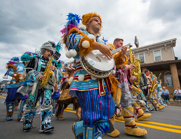 Members of the Quaker String Band, of Philadelphia, march down Main Street in Watsontown during the Gigantic Sesquicentennial Parade on Saturday morning.