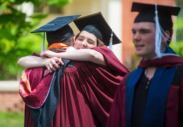 Jennie Lien, of Gilberstville hugs Kyle Kern, of Sunbury, before the start of Susquehanna Univeristy's graduation ceremony on Wednesday.
