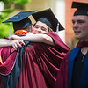 Jennie Lien, of Gilberstville hugs Kyle Kern, of Sunbury, before the start of Susquehanna Univeristy's graduation ceremony on Wednesday.