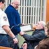 Miflinburg Community Ambulance paramedics, Mike Lesher and Anthony Pirraglia shake XXXXX's hand during a MIfflinburg borough council meeting after receiving recognition for their work in saving XXXXX's life.
