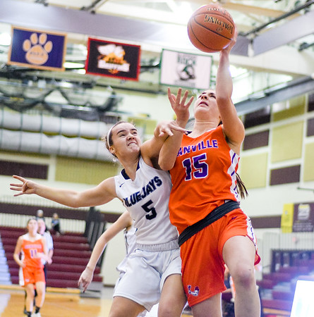 Danville's Clara Coombe shoots while being fouled by Central Columbia's Gracia Eckenrode during Wednesday night's game in Bloomsburg.